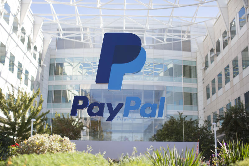 The PayPal logo in front of the company's headquarters building.