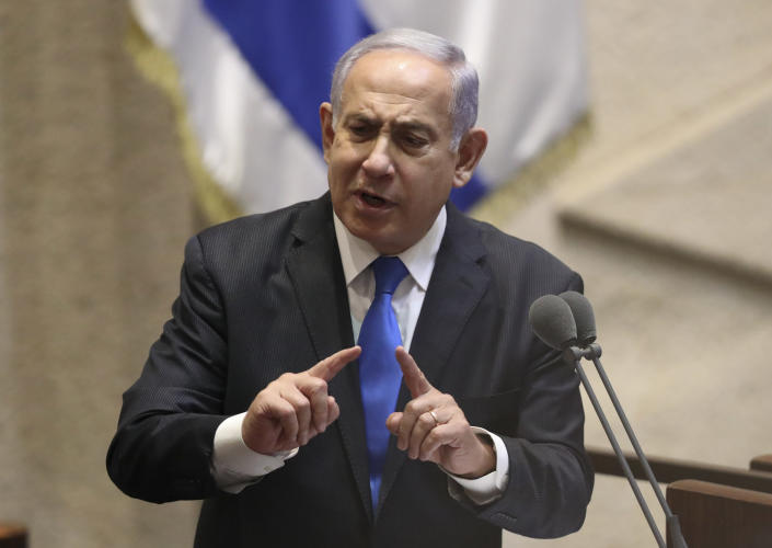 Israel's outgoing prime minister Benjamin Netanyahu speaks during a Knesset session in Jerusalem Sunday, June 13, 2021. Bennett is expected later Sunday to be sworn in as the country's new prime minister, ending Prime Minister Benjamin Netanyahu's 12-year rule. (AP Photo/Ariel Schali22