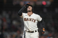 San Francisco Giants' Thairo Estrada gestures after hitting a home run against the San Diego Padres during the third inning of a baseball game in San Francisco, Wednesday, Sept. 15, 2021. (AP Photo/Jeff Chiu)