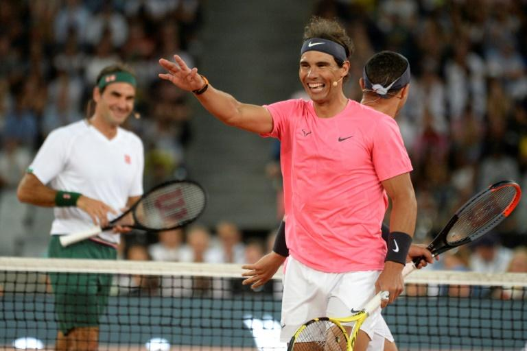Putting on a show: Federer and Nadal were miked up as they enjoyed themselves playing an exhibition doubles with American billionaire Bill Gates and South African comedian Trevor Noah