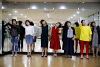 Middle-aged people attend a senior model class in Seoul