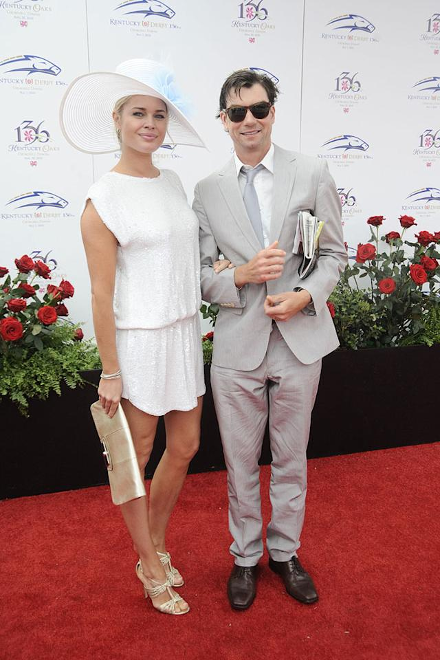 "Also out for the annual horse race were Rebecca Romijn, sporting an elegant white ensemble, and hubby Jerry O'Connell, who really should have ironed his pants! Jeff Gentner/<a href=""http://www.gettyimages.com/"" target=""new"">GettyImages.com</a> - May 1, 2010"