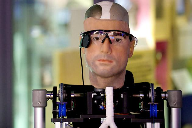 """A picture shows """"Rex"""", the world's first """"bionic man"""", during a photo call at the Science Museum in London on February 5, 2013. The 640,000 GBP (1 million US dollars) humanoid has a distinctly human shape and boasts prosthetic limbs, a functional artificial blood circulatory system complete with artificial blood, as well as an artificial pancreas, kidney, spleen and trachea. Rex will be displayed at the Science Museum from February 7.  AFP PHOTO/ANDREW COWIE"""