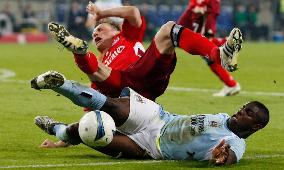 Micah Richards tackles Hamburg SV's Ivica Olic during Manchester City's Uefa Cup quarter-final match in April 2009 9, 2009.