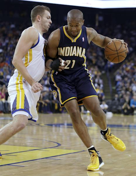Indiana Pacers' David West, right, drives the ball past Golden State Warriors' David Lee during the first half of an NBA basketball game, Monday, Jan. 20, 2014, in Oakland, Calif. (AP Photo/Ben Margot)