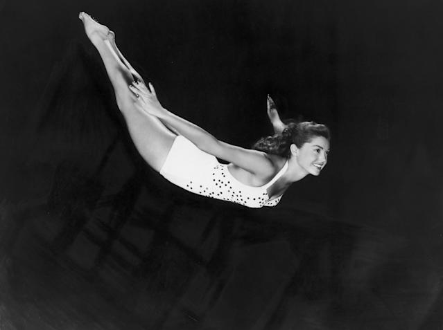 American actress and swimmer Esther Williams dives through the air in a one-piece swimsuit, c. 1945. (Photo: Hulton Archive/Getty Images)