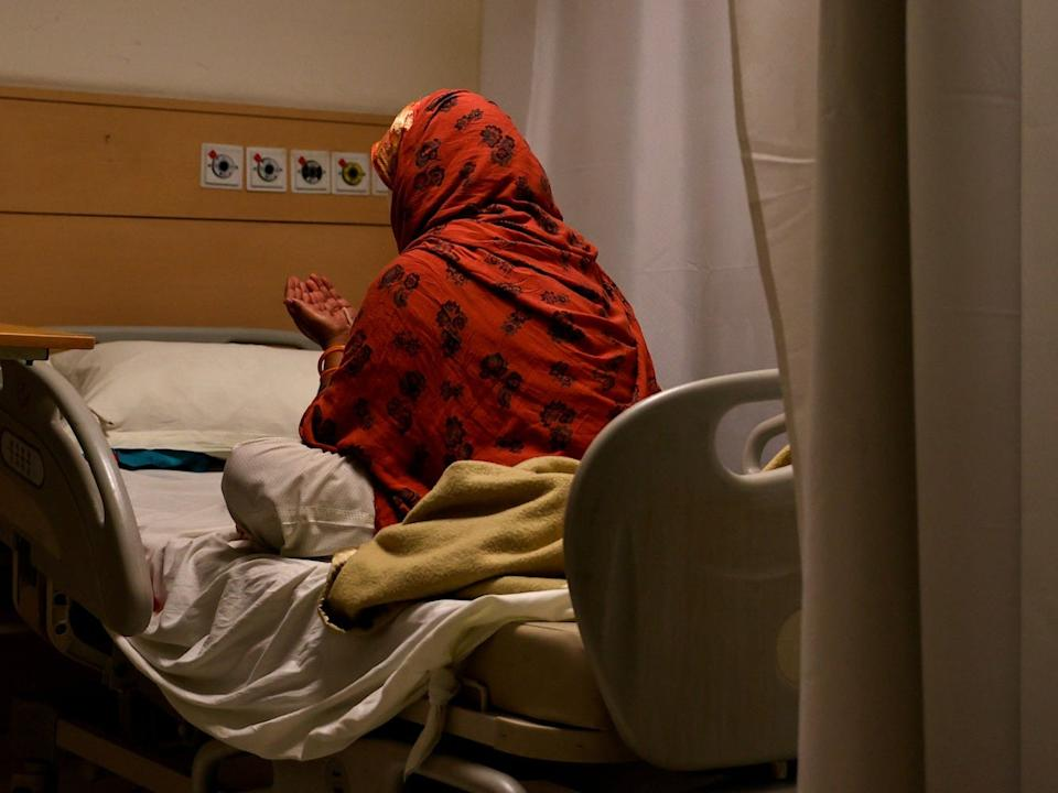 A patient suffering from the coronavirus disease prays at the emergency ward of Max Smart Super Speciality Hospital in New Delhi, India, on May 28, 2020.