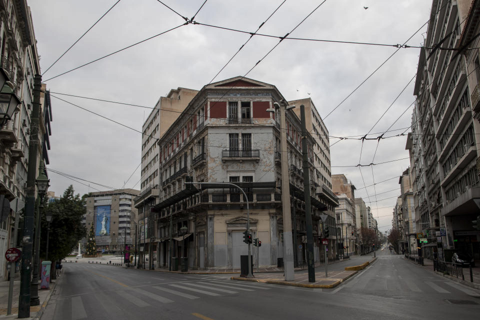 Empty streets near Omonoia square, in central Athens, Sunday, Dec. 20, 2020, during a lockdown to contain the coronavirus pandemic. The number of visitors traveling to the country plummeted by 76.1% on the year in the first 10 months of 2020. Spending also sank by 77%, according to central bank data released on December. (AP Photo/Petros Giannakouris)