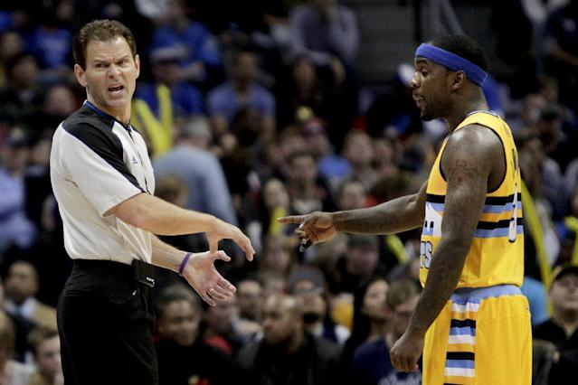 Referee Mark Ayotte, left, and Denver Nuggets' Ty Lawson, right, discuss a call during the first quarter of an NBA basketball game against the Oklahoma City Thunder, Thursday, Jan. 9, 2014, in Denver. (AP Photo/Barry Gutierrez)
