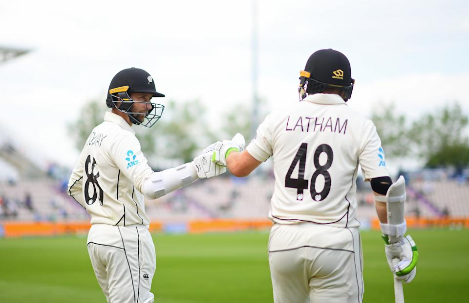 SOUTHAMPTON, ENGLAND - JUNE 23: Devon Conway and Tom Latham of New Zealand head out to bat during the Reserve Day of the ICC World Test Championship Final between India and New Zealand at The Hampshire Bowl on June 23, 2021 in Southampton, England. (Photo by Alex Davidson/Getty Images)