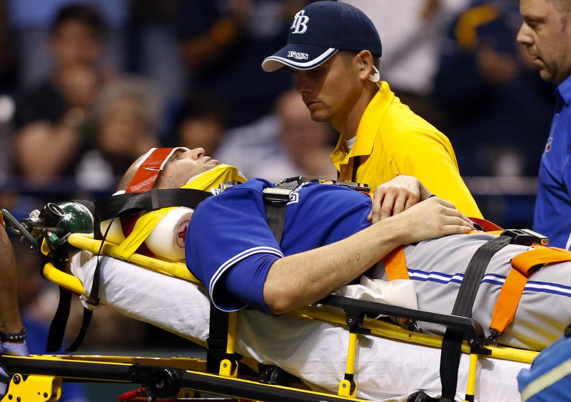 Toronto Blue Jays' J.A. Happ is attended to by medical personnel as he is taken off the field on a stretcher after being hit in the head by a line drive by Tampa Bay Rays' Desmond Jennings during the second inning of a baseball game Tuesday, May 7, 2013, in St. Petersburg, Fla. (AP Photo/Mike Carlson)