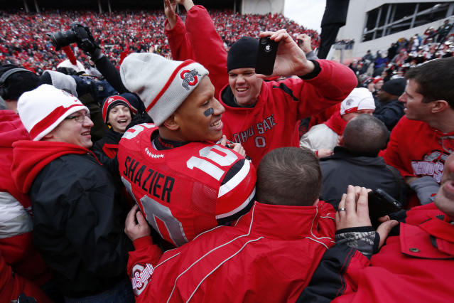 Ryan Shazier, pictured in the middle of a celebration after beating Michigan in 2012, played three years at Ohio State before the Steelers drafted him with the 15th overall pick in 2014. (Getty Images)