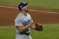 Los Angeles Dodgers relief pitcher Blake Treinen celebrates their win against the Tampa Bay Rays in Game 5 of the baseball World Series Sunday, Oct. 25, 2020, in Arlington, Texas. Dodgers beat the Rays 4-2 to lead the series 3-2 games. (AP Photo/Tony Gutierrez)