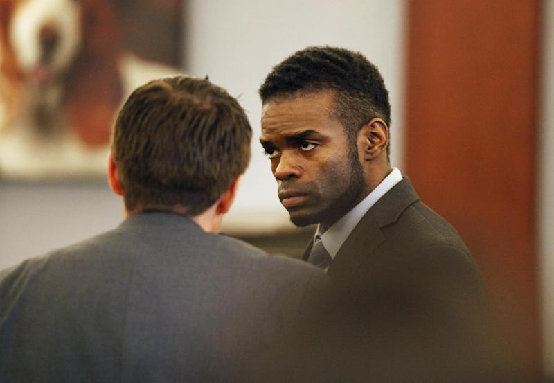 """Jason Omar Griffith appears in court during his trial at the Regional Justice Center Thursday, May 8, 2014, in Las Vegas. Griffith is accused of murdering Luxor """"Fantasy"""" dancer Deborah Flores Narvaez in December 2010. (AP Photo/Las Vegas Review-Journal, John Locher) LOCAL TV OUT; LOCAL INTERNET OUT; LAS VEGAS SUN OUT"""