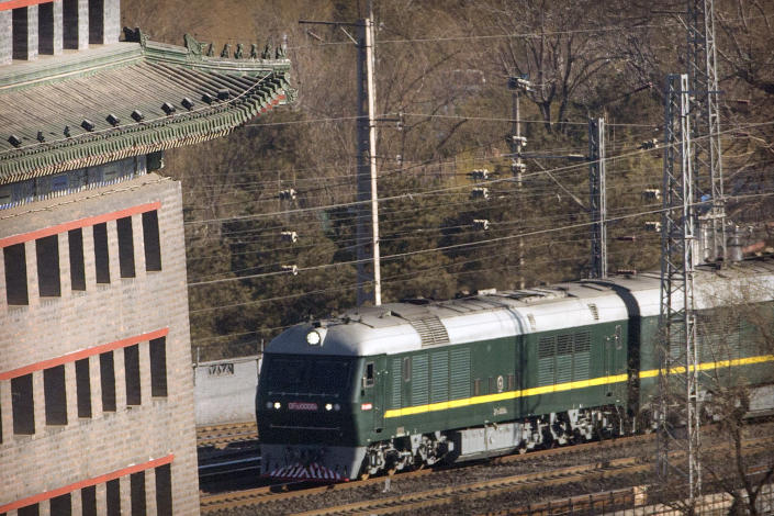 """FILE - In this Tuesday, Jan. 8, 2019, file photo,a train similar to one seen during previous visits by North Korean leader Kim Jong Un arrives at Beijing Railway Station in Beijing. For his second summit with President Donald Trump, Kim Jong Un opted to travel retro _ riding the rails like his grandfather decades before. The decision was likely part security and part optics, designed to bring back memories of North Korean """"eternal president"""" Kim Il Sung's many travels by train. (AP Photo/Mark Schiefelbein, File)"""