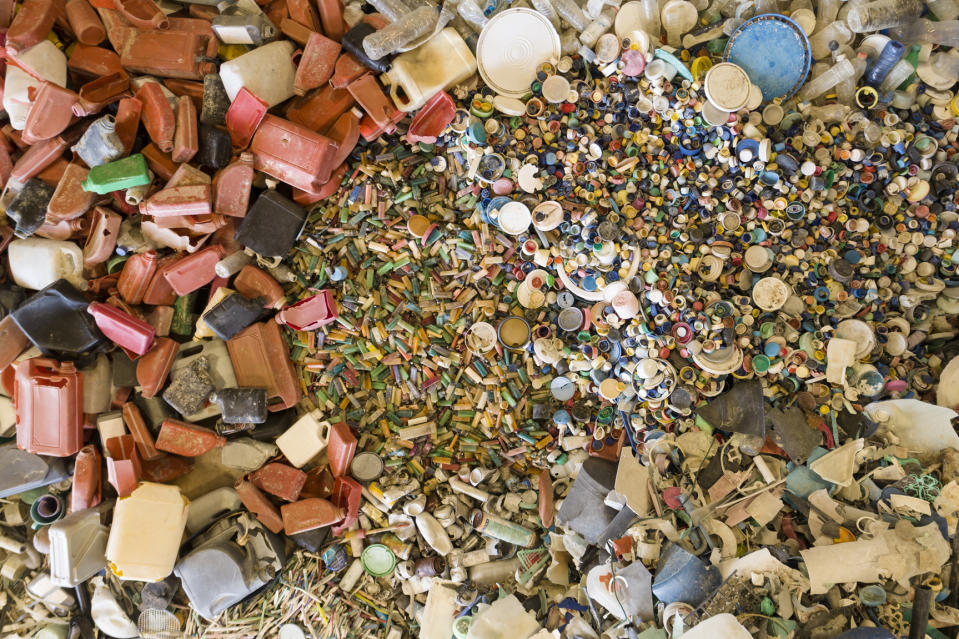 An aerial view of lighters, bottle caps, oil bottles and other items collected from Djulpan Beach.