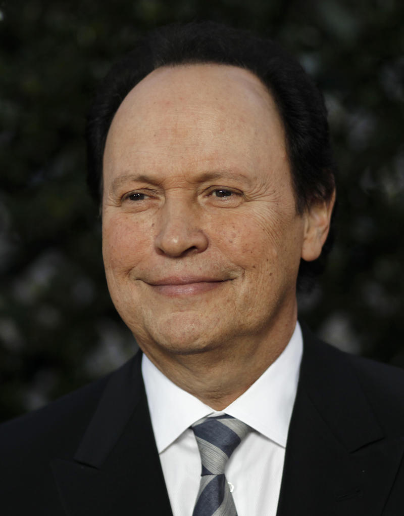 FILE - In this May 4, 2011 file photo, Billy Crystal arrives at The Academy of Motion Picture Arts and Sciences Tribute honoring Sophia Loren in Beverly Hills, Calif.  Crystal returns as host for the 84th Academy Awards on Sunday, Feb. 26, 2012. (AP Photo/Matt Sayles, file)