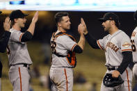 The San Francisco Giants celebrate after a win over the Los Angeles Dodgers in a baseball game Friday, May 28, 2021, in Los Angeles. (AP Photo/Marcio Jose Sanchez)