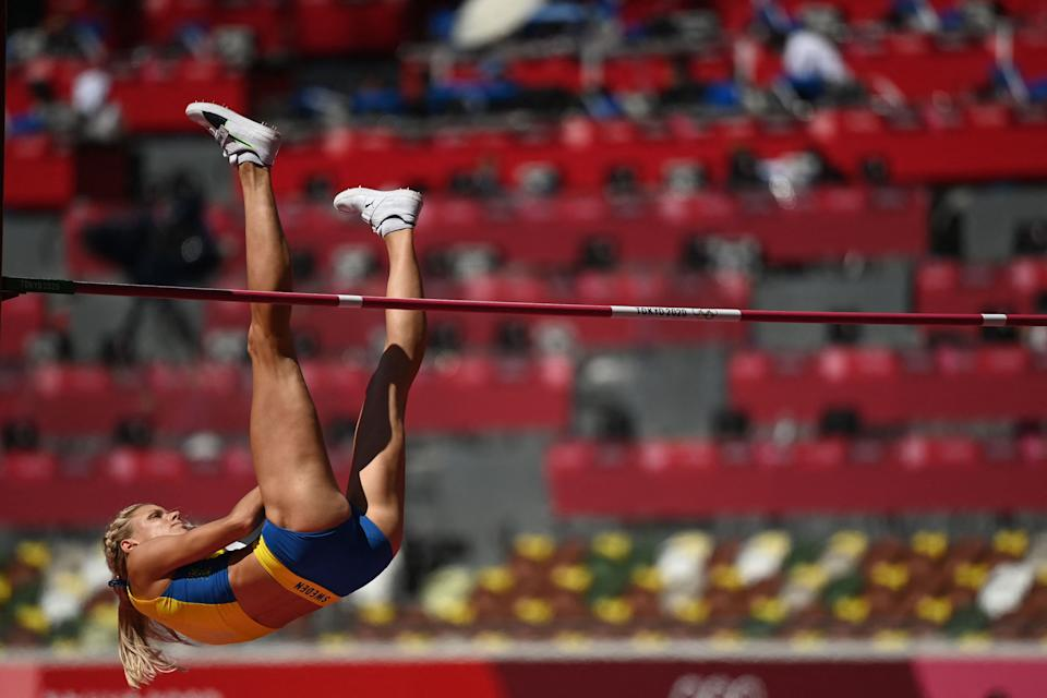 <p>Sweden's Erika Kinsey competes in the women's high jump qualification during the Tokyo 2020 Olympic Games at the Olympic Stadium in Tokyo on August 5, 2021. (Photo by Jonathan NACKSTRAND / AFP)</p>