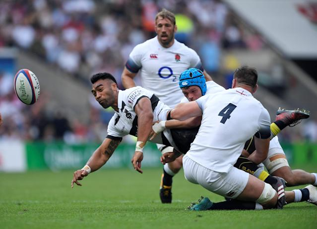 Rugby Union - England v Barbarians, Twickenham Stadium, London, Britain - May 27, 2018 Barbarians' Victor Vito in action with England's Eliott Stooke Action Images via Reuters/Tony O'Brien