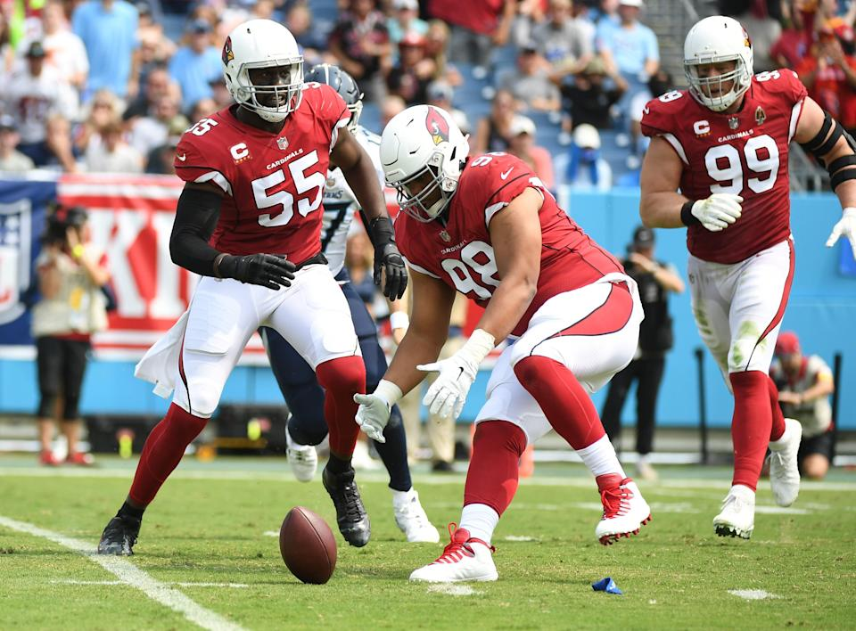 Sep 12, 2021; Nashville, Tennessee, USA; Arizona Cardinals defensive tackle Corey Peters (98) recovers a fumble after a sack fumble forced by Arizona Cardinals defensive end Chandler Jones (55) during the first half against the Tennessee Titans at Nissan Stadium. Mandatory Credit: Christopher Hanewinckel-USA TODAY Sports