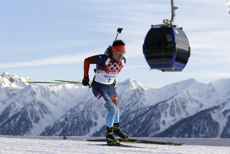 Russia's Yevgeny Garanichev skis past a gondola during the men's biathlon 20k individual race, at the 2014 Winter Olympics, Thursday, Feb. 13, 2014, in Krasnaya Polyana, Russia. (AP Photo/Kirsty Wigglesworth)