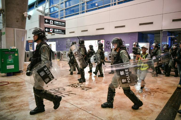 Police entered Tung Chung metro station after protesters blocked several routes leading to Hong Kong's airport (AFP Photo/Anthony WALLACE)