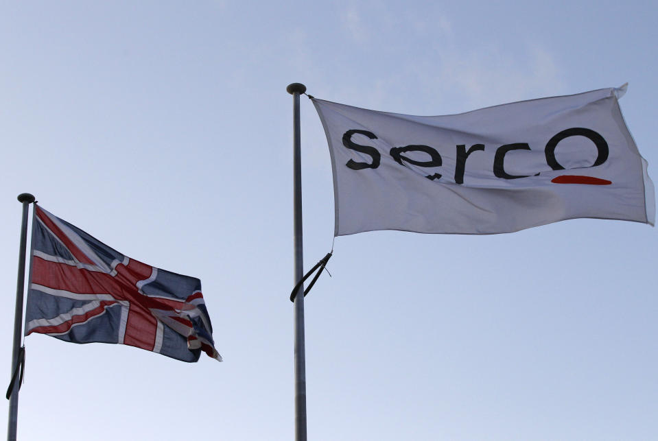 A Serco flag is seen flying alongside a Union flag