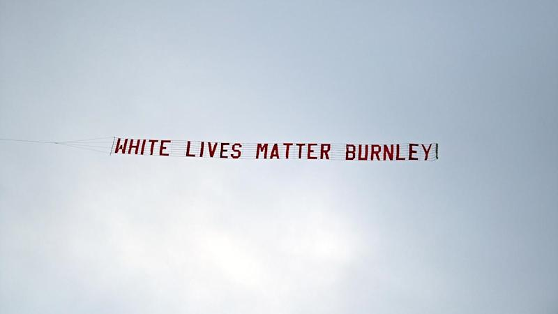 A 'White Lives Matter Burnley' banner is flown above the Eithad Stadium on Monday night