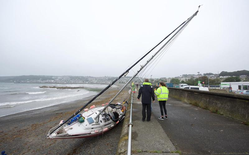 This luckless sailor's yacht has been blown on to the beach at Penzance in Cornwall - KRIS MEADEN/APEX