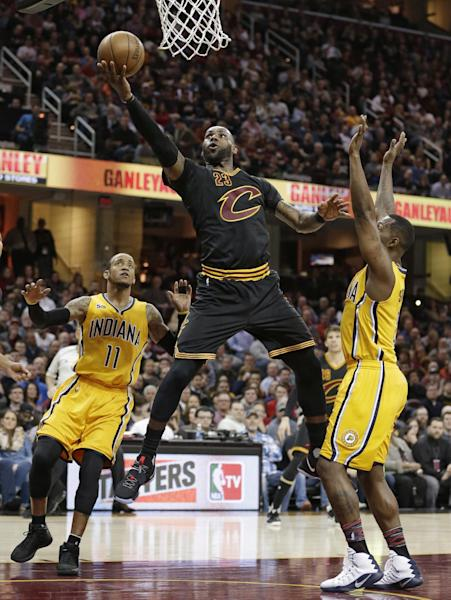 Cleveland Cavaliers' LeBron James (23) drives to the basket against Indiana Pacers' Monta Ellis (11) and Rodney Stuckey (2) in the first half of an NBA basketball game, Wednesday, Feb. 15, 2017, in Cleveland. The Cavaliers won 113-104. (AP Photo/Tony Dejak)
