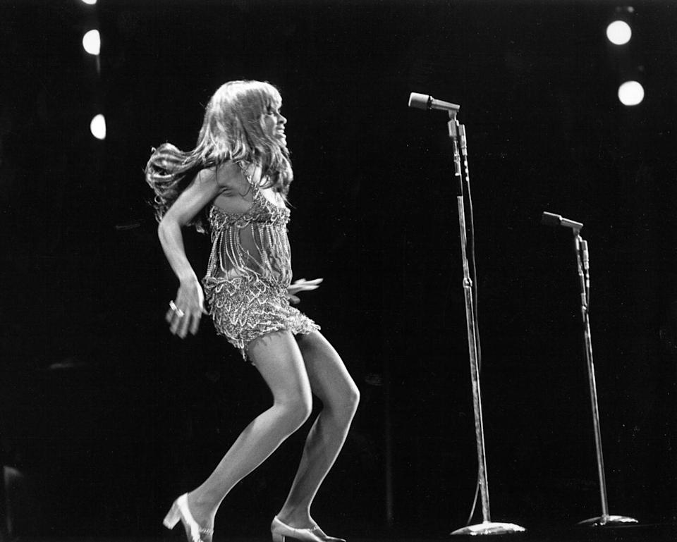 """<p>On stage in one of her one of her famously glitzy costumes. </p><p><strong>RELATED:</strong> <a href=""""https://www.womansday.com/life/entertainment/g33132155/hollywood-photos/"""" rel=""""nofollow noopener"""" target=""""_blank"""" data-ylk=""""slk:What Hollywood Looked Like the Year You Were Born"""" class=""""link rapid-noclick-resp"""">What Hollywood Looked Like the Year You Were Born</a></p>"""