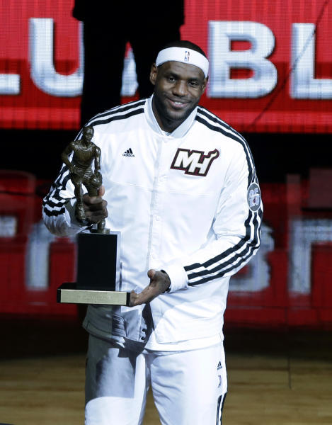 Miami Heat's LeBron James smiles after receiving his MVP trophy from NBA Commissioner David Stern during a ceremony before Game 1 of their NBA basketball playoff series in the Eastern Conference semifinals, Monday, May 6, 2013, in Miami. (AP Photo/Lynne Sladky)