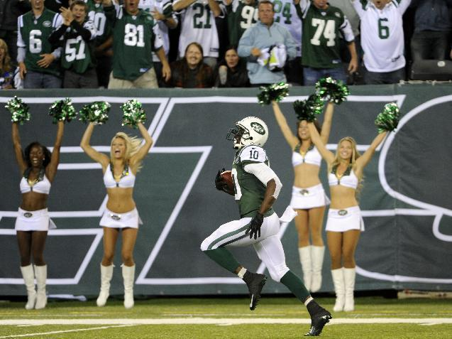 New York Jets wide receiver Santonio Holmes (10) runs for a touchdown after catching a pass from Geno Smith during the second half of an NFL football game against the Buffalo Bills Sunday, Sept. 22, 2013, in East Rutherford, N.J. (AP Photo/Bill Kostroun)