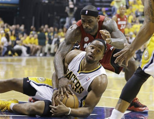 Indiana Pacers forward Sam Young battles for a loose ball against Miami Heat forward LeBron James during the first half of Game 6 of the NBA Eastern Conference basketball finals in Indianapolis, Saturday, June 1, 2013. (AP Photo/Michael Conroy)