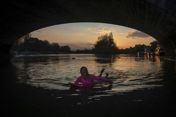 Teal came to the British capital in March before the coronavirus lockdown, after also surfing on the Seine in Paris in 2018 (AFP Photo/Olivier MORIN)