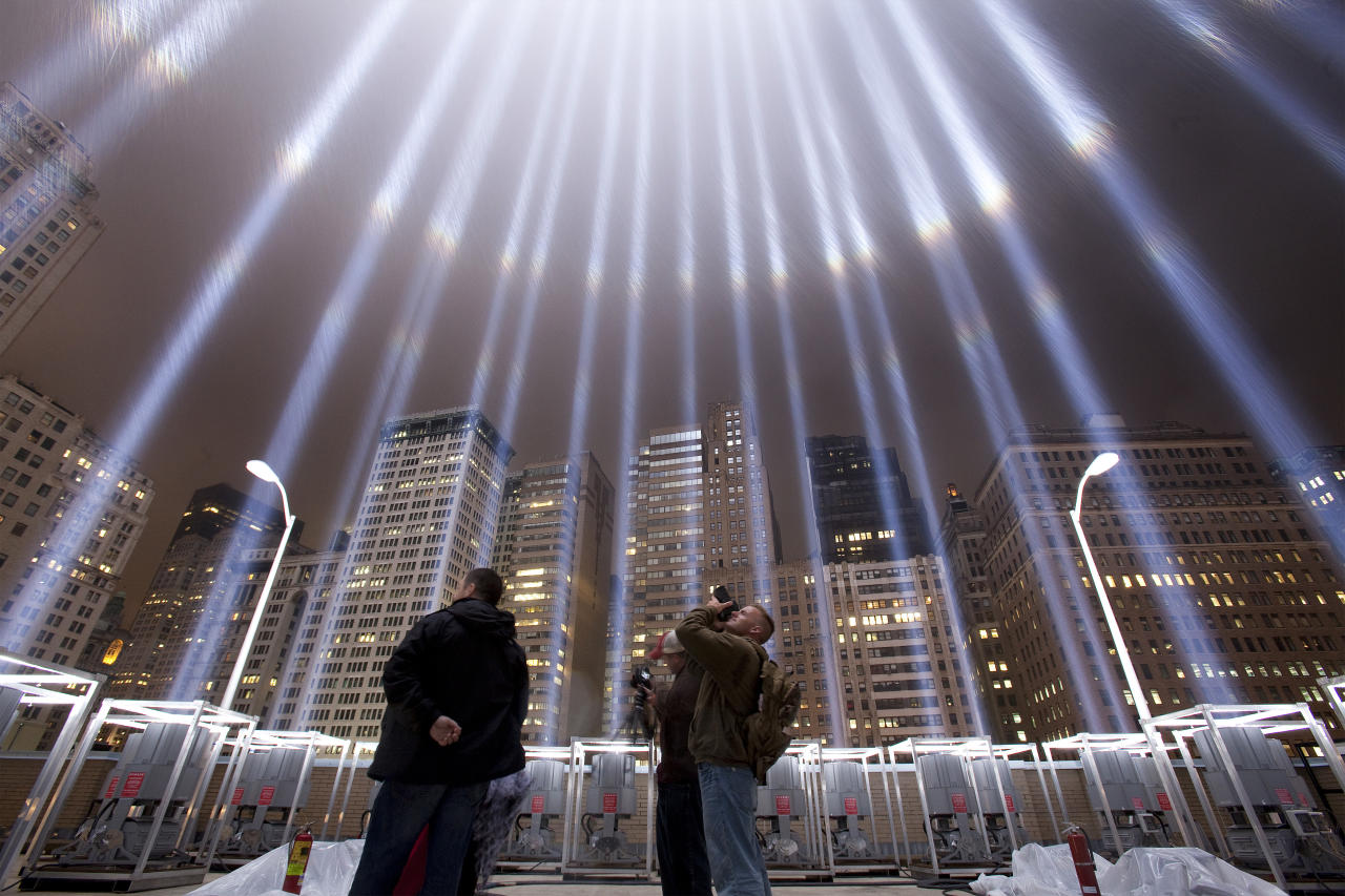 "Onlookers stand inside of the ""Tribute in Lights"" in Manhattan on the eighth anniversary of the attack on the World Trade Center in New York September 11, 2009. (REUTERS/Lucas Jackson)"
