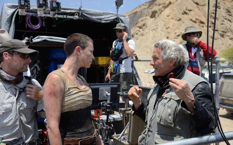 Charlize Theron on set with George Miller - AP