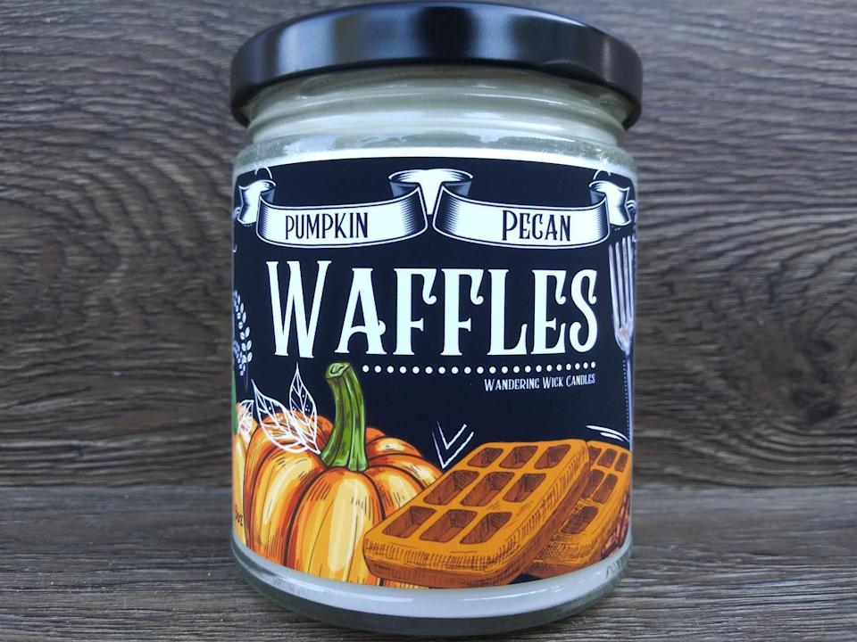 """If you're asking us what smells better than waffles and maple syrup hot and ready for breakfast, we're going to tell you: Pumpkin pecan waffles and maple syrup hot and ready for breakfast. This candle mimics that exactly smell, and more. With notes of butter, cinnamon, apple, cherry, and maple syrup, this candle will make your entire home smell like the sweet days of the autumn at your grandma's. $10, Etsy. <a href=""""https://www.etsy.com/listing/830283991/pumpkin-pecan-waffles-soy-candle"""" rel=""""nofollow noopener"""" target=""""_blank"""" data-ylk=""""slk:Get it now!"""" class=""""link rapid-noclick-resp"""">Get it now!</a>"""