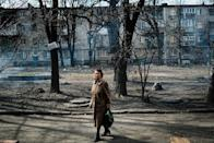 A picture taken on March 27, 2015, shows a woman walking in Kievsky district in the eastern Ukrainian city of Donetsk (AFP Photo/Dimitar Dilkoff)