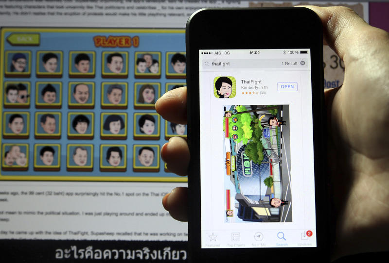 In this Thursday, Dec. 12, 2013 photo, a ThaiFight app is displayed on a smartphone and ready to be played, in Bangkok, Thailand. For years, protesters in the country have used social media to organize rallies. Now they're taking smartphones to a new level. Apps have been created that allow phones to help protesters perform the high-pitched, raucous noisemaking that is a staple of Thai demonstrations. (AP Photo/Apichart Weerawong)
