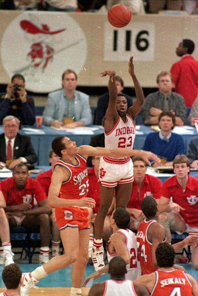 FILE - In this file photo taken March 30, 1987, Indiana's Keith Smart (23) fires a shot past Syracuse's Howard Triche for a basket, putting Indiana ahead by one point in the final seconds of the NCAA Championship game in New Orleans. Known by Hoosiers fans to this day as ``The Shot,'' and known in much less complimentary terms by Syracuse faithful, that 16-foot jumper from the left side with 5 seconds to play is a film clip staple throughout March. (AP Photo/Bill Haber, File)