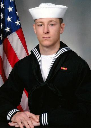 Electronics Technician 3rd Class Kenneth Aaron Smith, 22, from Cherry Hill, New Jersey, who was stationed aboard the USS John S. McCain when it collided with a merchant vessel in waters near Singapore and Malayasia, August 21, 2017, is shown in this undated photo provided August 24, 2017. U.S. Navy/Handout via REUTERS