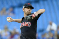 Cleveland Indians starting pitcher Shane Bieber (57) throws against the Toronto Blue Jays during the first inning of a baseball game, Wednesday, July 24, 2019 in Toronto. (Nathan Denette/Canadian Press via AP)
