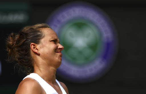 Czech Republic's Barbora Strycova grimaces as she plays United States' Serena Williams in a Women's semifinal singles match on day ten of the Wimbledon Tennis Championships in London, Thursday, July 11, 2019. (Hannah McKay/Pool Photo via AP)