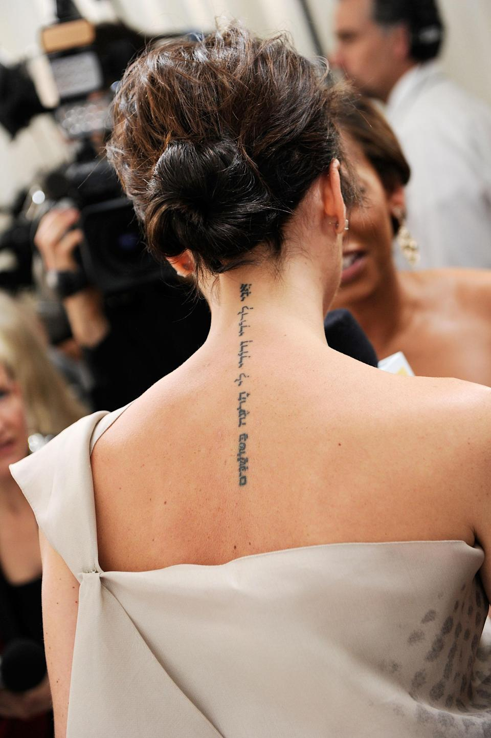 """<p>Victoria's back tattoo running down her spine was iconic at the time, but she's since has it removed. It read, """"Ani l'dodi li va'ani lo haroeh bashoshanim"""", in Hebrew which means """"I am my beloved's and my beloved is mine"""".<br>[Photo: Getty] </p>"""