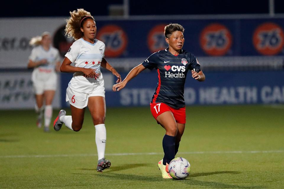The Washington Spirit's Kumi Yokoyama, right, is chased by Chicago Red Stars Casey Short during a June 27, 2020 Challenge Cup match in Salt Lake City.