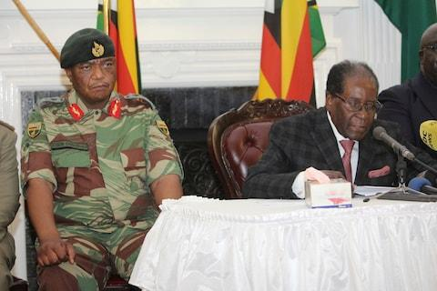 Gen Constantino Chiwenga, head of the Zimbabwean military, looks on while Robert Mugabe reads a speech on Sunday - Credit:  Tsvangirayi Mukwazhi/AP