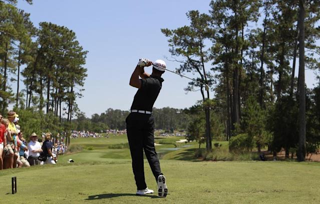 Tiger Woods hits from the fourth tee during the second round of the Players Championship golf tournament at TPC Sawgrass, Friday, May 11, 2012, in Ponte Vedra Beach, Fla. (AP Photo/John Raoux)