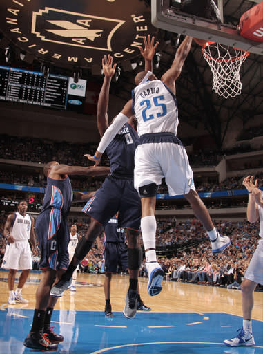 DALLAS, TX - NOVEMBER 3: Vince Carter #25 of the Dallas Mavericks flies in for the dunk against Bismack Biyombo #0 of the Charlotte Bobcats on November 3, 2012 at the American Airlines Center in Dallas, Texas. (Photo by Danny Bollinger/NBAE via Getty Images)